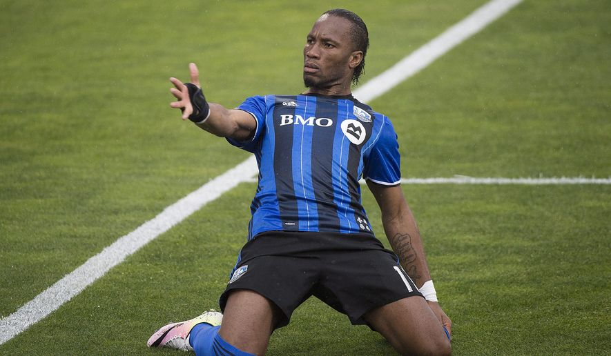 Montreal Impact's Didier Drogba celebrates after scoring against the Philadelphia Union during first-half MLS soccer game action in Montreal, Saturday, May 14, 2016. (Graham Hughes/The Canadian Press via AP) MANDATORY CREDIT