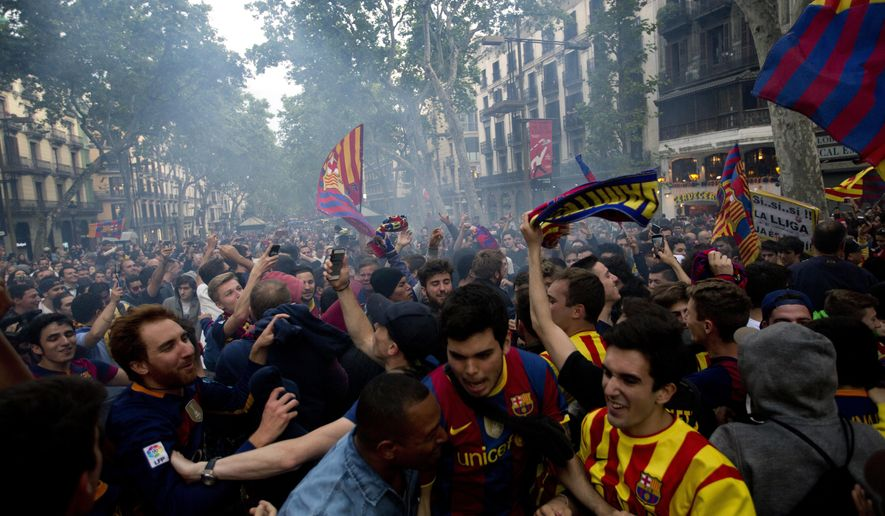 FC Barcelona supporters celebrate their team's victory in the Spanish league title at Canaletas source at Las Ramblas, in Barcelona, Spain, Saturday, May 14, 2016. (AP Photo/Emilio Morenatti)