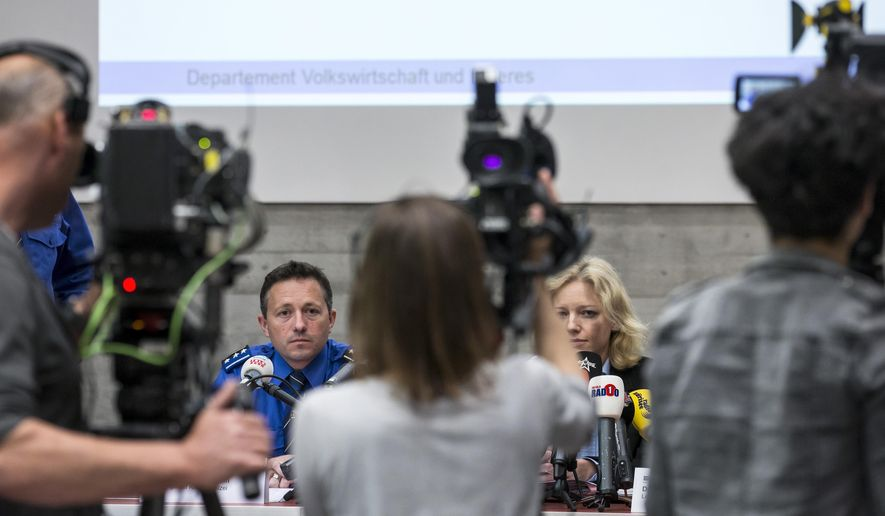 """In this Friday May 13, 2016 picture Ppolice captain  Markus Gisin, left, and prosecutor Barbara Loppacher, right inform  the media in Schafisheim, Switzerland. about the killing of a family in Rupperswil in December.  Officials in the nearby  Swiss town of Rupperswil are expressing shock after the arrest of a 33-year-old soccer coach over the killing of four people. The Swiss man, identified by local media as Thomas N., is suspected of killing a mother, her two sons and the older son's girlfriend in December. Prosecutors say the suspect made a """"comprehensive confession"""" after his arrest Thursday.  (Alexandra Wey/Keystone via AP)"""