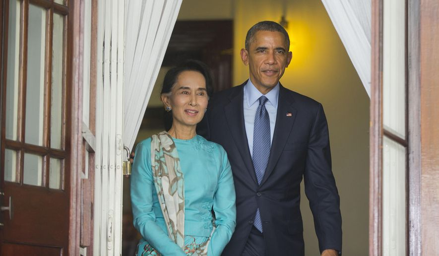 FILE - In this Nov. 14, 2014 file photo, Aung San Suu Kyi, walks with President Barack Obama for their joint news conference at her home in Yangon, Myanmar. The U.S. business lobby says it is high time to drop the remaining U.S. sanctions on Myanmar, but human rights activists and U.S. lawmakers say not so fast. That poses a dilemma for President Barack Obama, who next week is expected to renew sanctions for another year but take some state-run companies off a Treasury blacklist. (AP Photo/Pablo Martinez Monsivais, File)