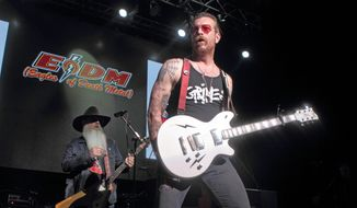 Dave Catching, left, and Jesse Hughes of Eagles of Death Metal perform during the Sweetlife Festival at Merriweather Post Pavilion on Saturday, May 14, 2016, in Columbia, Md. (Photo by Owen Sweeney/Invision/AP) ** FILE **