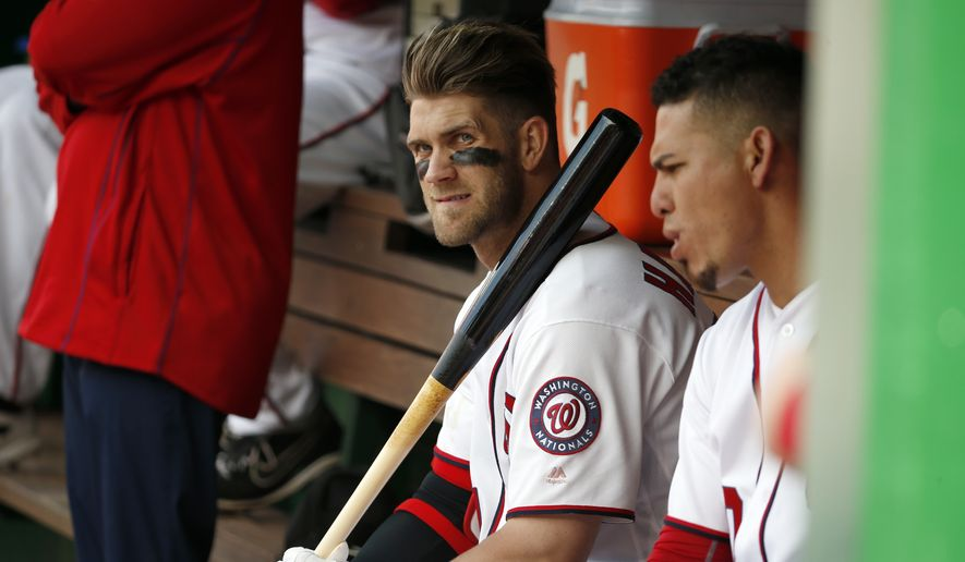 Washington Nationals right fielder Bryce Harper (34) waits to bat during the ninth inning of a baseball game against the Miami Marlins at Nationals Park, Sunday, May 15, 2016, in Washington. Marlins won 5-1. (AP Photo/Alex Brandon)