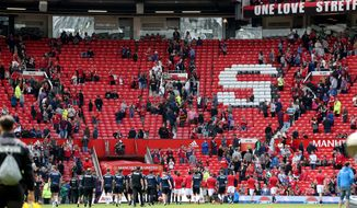 Fans leave the stands after a security announcement during the English Premier League match at Old Trafford, Manchester, England. Sunday May 15, 2016. Manchester United's final game of the season against AFC Bournemouth at Old Trafford has been abandoned. (Martin Rickett/ / PA via AP) UNITED KINGDOM OUT - NO SALES - NO ARCHIVES