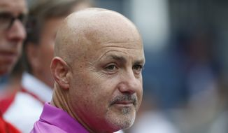Washington Nationals general manager Mike Rizzo, watches batting practice before a baseball game against the Chicago Cubs at Nationals Park, Friday, June 5, 2015, in Washington. (AP Photo/Alex Brandon)
