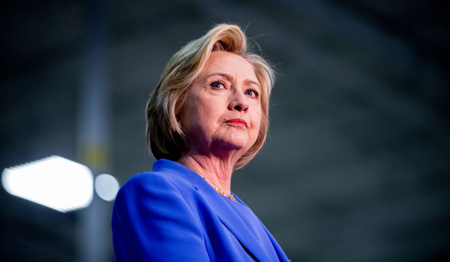Democratic presidential candidate Hillary Clinton stands on stage at the Union of Carpenters and Millwrights Training Center during a campaign stop in Louisville, Ky., Sunday, May 15, 2016. (AP Photo/Andrew Harnik)