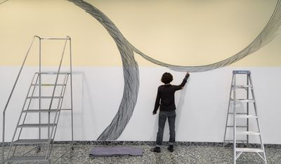"""Linn Meyers at work on """"Our View from Here"""" (2016) at the Hirshhorn Museum and Sculpture Garden, Smithsonian Institution, Washington, D.C.  (Cathy Carver)"""