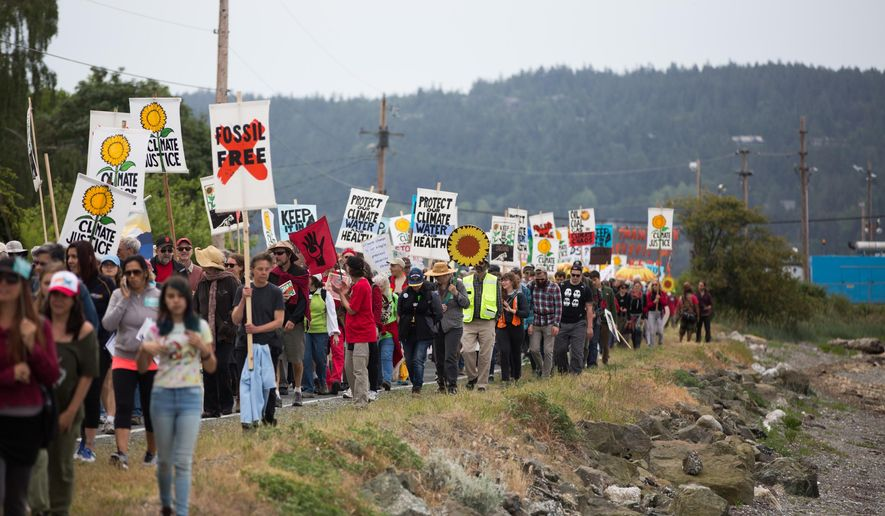 "Protesters march towards the tip of March Point during the Break Free PNW Indigenous Day of Action near the oil refineries in Anacortes, Wash., on Saturday, May 14, 2016. The protests are part of a series of global actions calling on people to ""break free"" from dependence on fossil fuels. (Grant Hindsley/seattlepi.com via AP)"