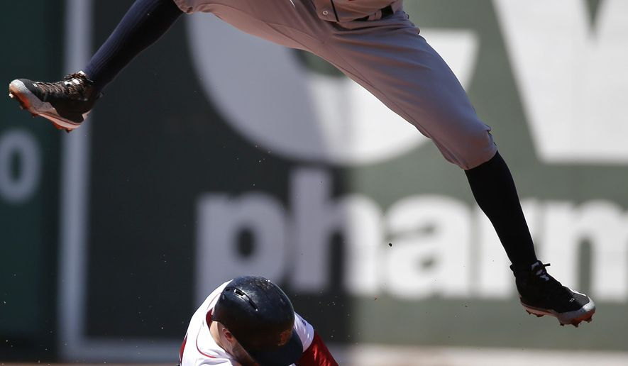 Boston Red Sox's Dustin Pedroia, bottom, steals second base as Houston Astros' Carlos Correa, top, waits for the ball in the first inning of a baseball game at Fenway Park, Sunday, May 15, 2016, in Boston. (AP Photo/Steven Senne)