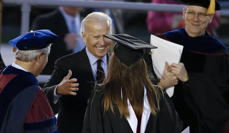 Vice President Joe Biden embraces his granddaughter Naomi Biden at her graduation ceremony, Sunday, May 15, 2016, at the University of Pennsylvania in Philadelphia. (AP Photo/Matt Rourke)