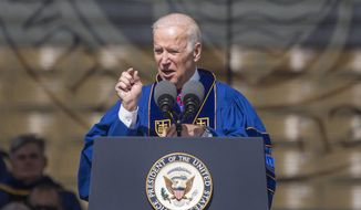 In this file photo, Vice President Joe Biden speaks to Notre Dame graduates after receiving the Laetare Medal, considered to be the oldest and most prestigious honor accorded to American Catholics, during the University of Notre Dame commencement ceremony on Sunday, May 15, 2016, inside Notre Dame Stadium in South Bend, Ind. (Robert Franklin/South Bend Tribune via AP)  **FILE**