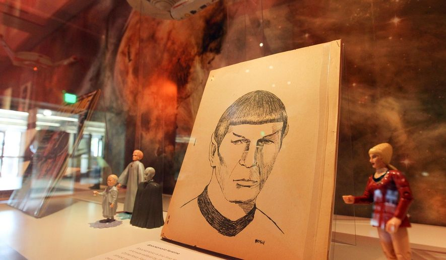 ADVANCE FOR USE SUNDAY, MAY 15 - In this photo taken Wednesday, May 4, 2016, Star Trek memorabilia is displayed at a special exhibit at the University of Iowa's Main Library in Iowa City, Iowa. (David Scrivner/Iowa City Press-Citizen via AP)  NO SALES; MANDATORY CREDIT