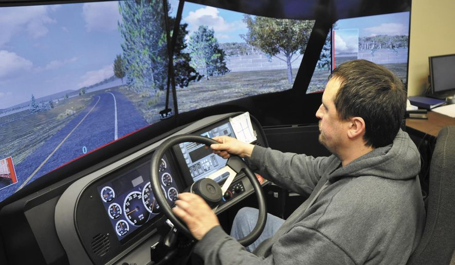 ADVANCE FOR USE SUNDAY, MAY 15 - In this photo taken April 7, 2016, Iowa Central Community College trucking student, Danny Gilliland, of Fort Dodge, Iowa, cruises along during a simulation at the college's transportation technology center in Fort Dodge, Iowa. (Chad Thompson/The Messenger via AP) MANDATORY CREDIT (REV-SHARE)