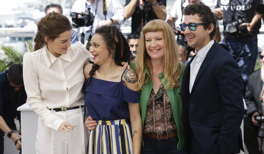Actors Riley Keough, Sasha Lane, director Andrea Arnold, and Shia Labeouf, from left, pose for photographers during a photo call for the film American Honey at the 69th international film festival, Cannes, southern France, Sunday, May 15, 2016. (AP Photo/Lionel Cironneau)