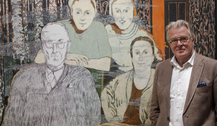 Dutch actor and artist Jeroen Krabbe poses in front of his painting   which tells the story of his grandfather Abraham Reiss, left, who was murdered in the Sobibor Nazi German extermination camp, during a press preview at the National Holocaust Museum in Amsterdam, Netherlands, Thursday, May 12, 2016. More than 70 years after tens of thousands of Dutch Jews were deported and murdered by the Nazis, the Netherlands is finally getting a national Holocaust museum. (AP Photo/Peter Dejong)