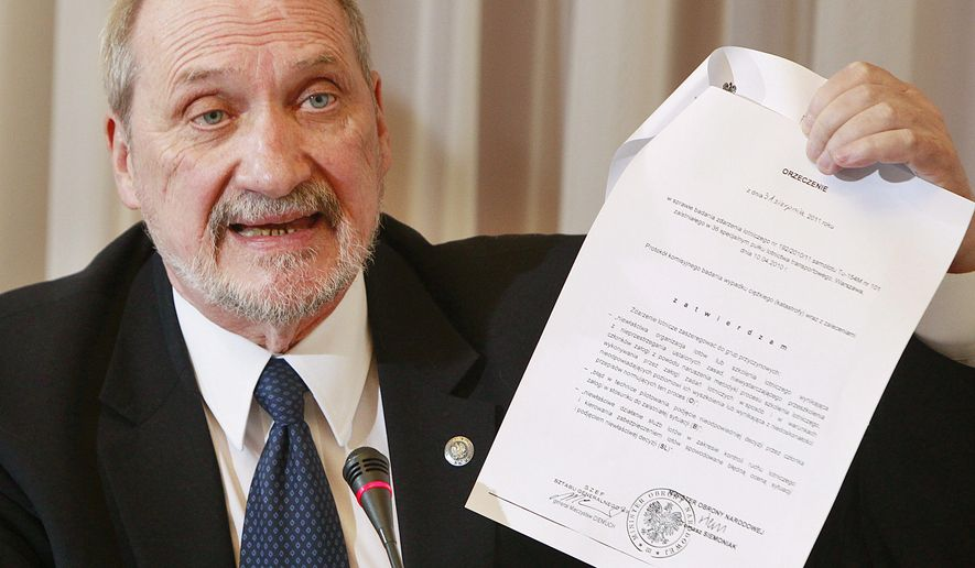 FILE - In this March 30, 2016  file  photo Poland's Defense Minister Antoni Macierewicz  shows a document during a session of a special parliamentary commission. in Warsaw . Several former Polish defense ministers are calling for Macierewicz's dismissal, arguing that he is undermining the image of Poland's military within NATO and in Polish society itself. (AP Photo/Czarek Sokolowski)