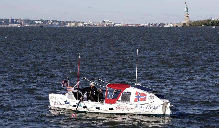 Stein Hoff rows past the Statue of Liberty, Sunday, May 15, 2016, in New York. The 70-year-old Norwegian is attempting to row singlehandedly across the Atlantic. Hoff is recreating the 1896 journey of two Norwegian-Americans, George Harbo and Gabriel Samuelsen, the first people to row across an ocean.(AP Photo/Mark Lennihan)