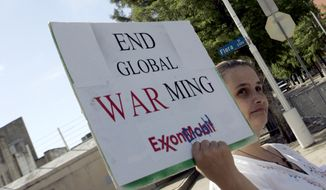 Valley Reed of Dallas was one of two demonstrators outside of the Exxon Mobil shareholders meeting in Dallas, Wednesday, May 27, 2009. (AP Photo/Mike Stone) ** FILE **