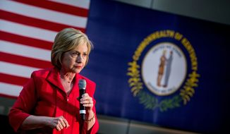 A Kentucky state flag is visible as Democratic presidential candidate Hillary Clinton pauses while speaking at a get out the vote event at James E. Bruce Convention Center in Hopkinsville, Ky., Monday, May 16, 2016. (AP Photo/Andrew Harnik) ** FILE **
