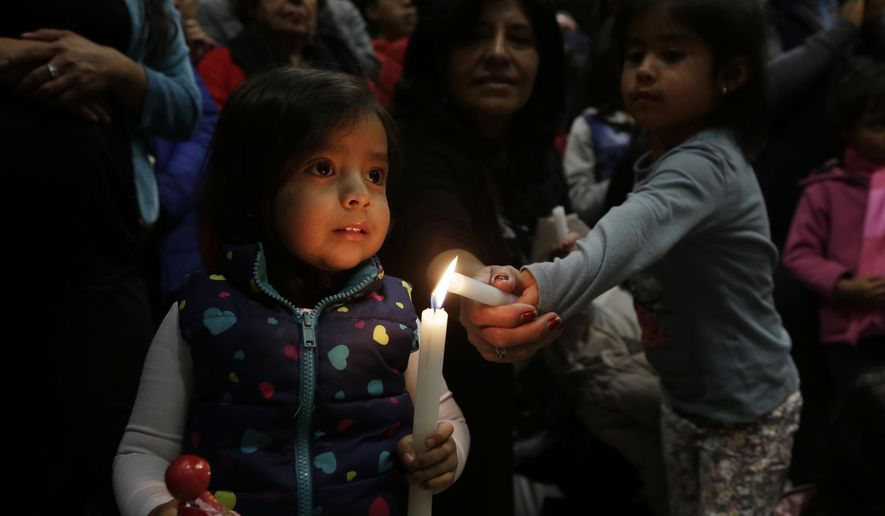 People light candles during a ceremony to mark the first month of the earthquake that hit the area of Manabi and Esmeraldas, in Quito, Ecuador, Monday, May 16, 2016. A month after the magnitude 7.8 earthquake many Ecuadorians are still struggling. (AP Photo/Dolores Ochoa)