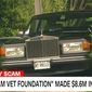 A Rolls Royce belonging to J. Thomas Burch, the CEO of the National Vietnam Veterans Foundation, prepares to speed away from a CNN reporter. (CNN screenshot)