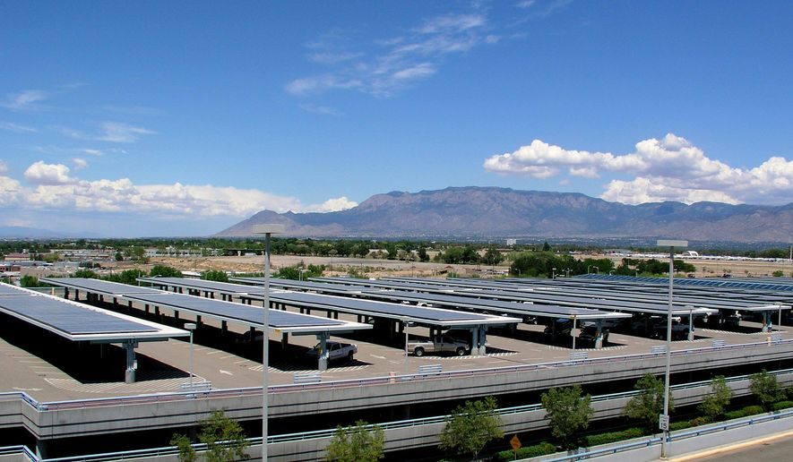 This undated image provided by the City of Albuquerque shows the rows of solar panels installed on the top level of the parking structure at the city's international airport in Albuquerque, N.M. Two Albuquerque city councilors have introduced a resolution that calls for 25 percent of the electricity used at city facilities to come from solar by 2025. (City of Albuquerque via AP)