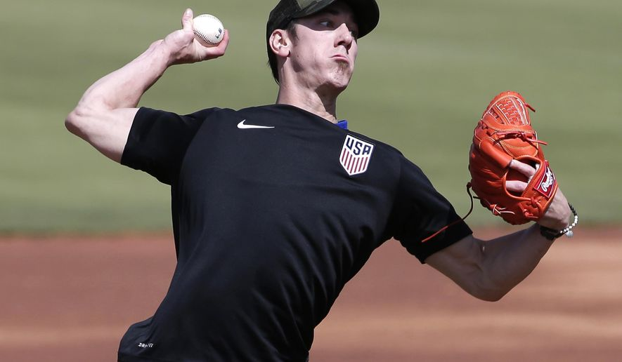 FILE - This May 6, 2016 file photo shows pitcher Tim Lincecum throwing for MLB baseball scouts at Scottsdale Stadium in Scottsdale, Ariz. The Los Angeles Angels are closing in on a deal to sign the two-time Cy Young Award winner, a free agent trying to come back from hip surgery, according to a person with knowledge of the negotiations, Monday, May 16, 2016. (AP Photo/Matt York, file)