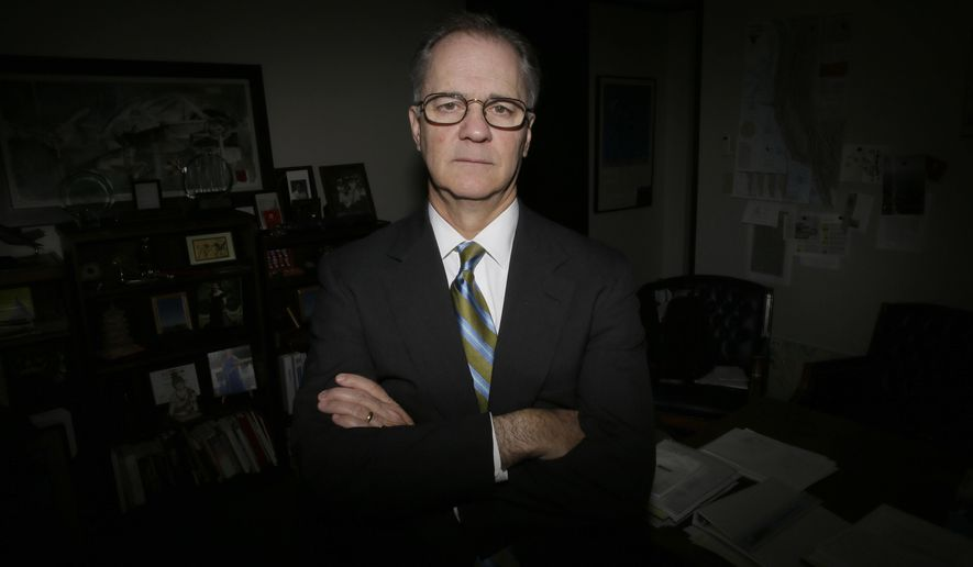 In this Friday, May 6, 2016, photo, Tang Energy CEO Patrick Jenevein poses for a photo in his office in Dallas. Several months earlier, Tang Energy won an arbitration case arising from a contract with Aviation Industry Corp., a conglomerate owned by the Chinese government. AVIC has challenged the ruling in federal court, arguing that as an arm of the Chinese government, it isn't subject to American arbitrators. (AP Photo/LM Otero)