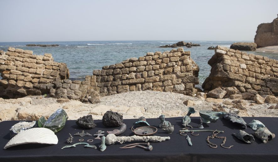 Rare bronze artifacts, part of a large ancient marine cargo of a merchant ship that sank during the Late Roman period 1,600 years ago seen during a presentation of the Israel Antiquities Authority in Caesarea, Israel. Monday, May 16, 2016. Israeli archeologists say two divers have made the country's biggest discovery of Roman-era artifacts in three decades. (AP Photo/Dan Balilty)
