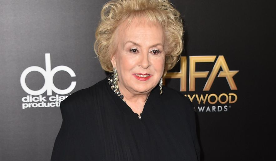"FILE - In this Nov. 1, 2015 file photo, Doris Roberts arrives at the Hollywood Film Awards in Beverly Hills, Calif. Roberts, who played the endlessly meddling mother on CBS' ""Everybody Loves Raymond,"" was remembered Monday as a tireless actress, a loyal friend and someone who could make even a monster on TV be adored. Roberts died April 17 at age 90. (Photo by Jordan Strauss/Invision/AP, File)"