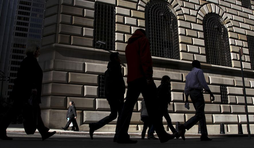 FILE - In this Thursday, Oct. 18, 2012, file photo, pedestrians walk past the Federal Reserve Bank of New York, in New York. On Monday, May 16, 2016, the Federal Reserve Bank of New York reports on factory activity in New York in May as indicated by its Empire State manufacturing index. (AP Photo/Seth Wenig, File)