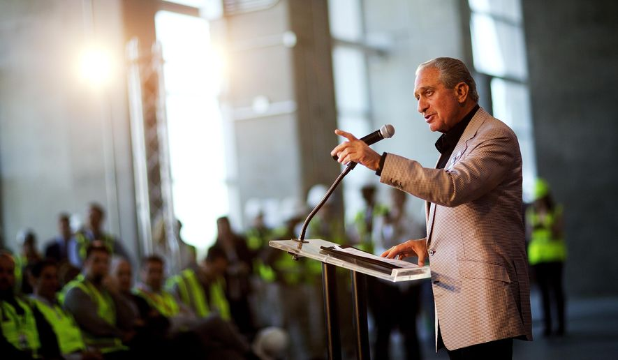Atlanta Falcons owner Arthur Blank speaks during a news conference inside the team's new stadium currently under construction Monday, May 16, 2016, in Atlanta. Blank says the Mercedes-Benz Stadium is on schedule to open in June, 2017 as scheduled and he's hoping it will be announced next week as the site of a Super Bowl. The Falcons also unveiled their new food and beverage plan which includes $2 hot dogs and soft drinks, a sharp decrease from current prices at the Georgia Dome. (AP Photo/David Goldman)