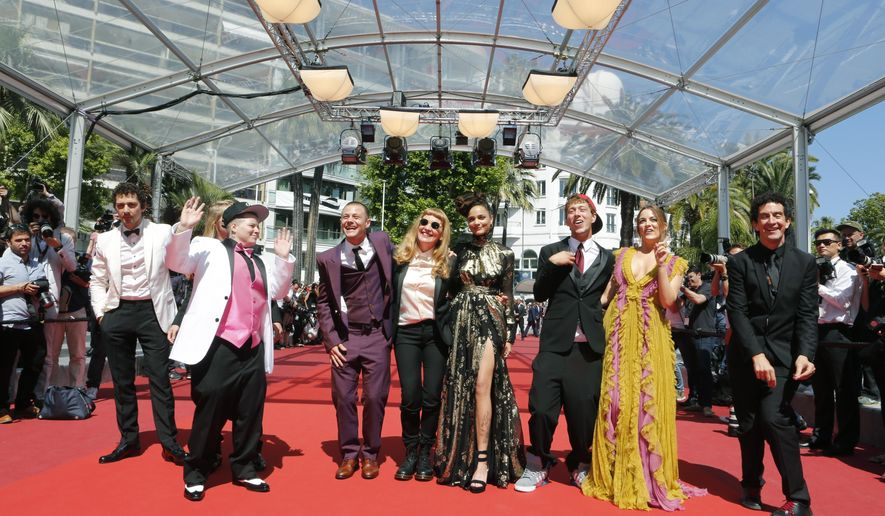 Actors Shia Labeouf, Isaiah Stone,obscured, Veronica Ezell, Mccaul Lombardi, director Andrea Arnold, Sasha Lane, Raymond Coalson and Riley Keough from left, pose for photographers upon arrival at the screening of the film American Honey at the 69th international film festival, Cannes, southern France, Sunday, May 15, 2016. (AP Photo/Lionel Cironneau)