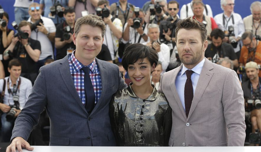 Actors Joel Edgerton, from right, Ruth Negga and director Jeff Nichols pose for photographers during a photo call for the film Loving at the 69th international film festival, Cannes, southern France, Monday, May 16, 2016.  (AP Photo/Lionel Cironneau)