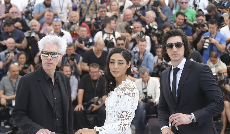 Director Jim Jarmusch, actress Golshifteh Farahani and actor Adam Driver, from left, pose for photographers during a photo call for the film Paterson at the 69th international film festival, Cannes, southern France, Monday, May 16, 2016. (AP Photo/Thibault Camus)