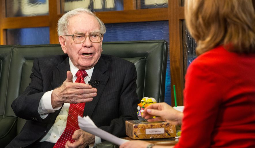 FILE - In this Monday, May 2, 2016, file photo, Berkshire Hathaway Chairman and CEO Warren Buffett speaks during an interview with Liz Claman on the Fox Business Network in Omaha, Neb. On Monday, May 16, 2016, Berkshire revealed that the company bought 9.8 million shares of Apple stock. (AP Photo/John Peterson, File)