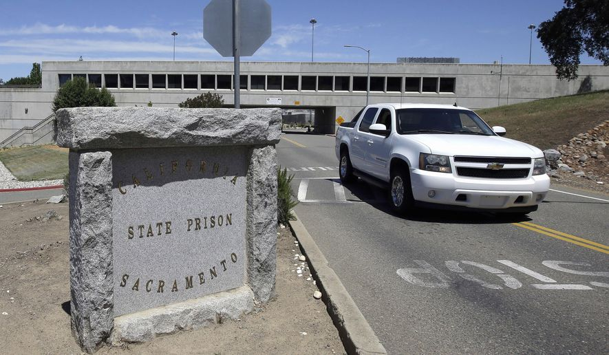 A vehicle drives by the main entrance to California State Prison, Sacramento, Monday, May 16, 2016, in Folsom, Calif. Authorities say one inmate was shot by a guard and another inmate was repeatedly stabbed during a fight among at least multiple inmates at the maximum security Northern California prison. (AP Photo/Rich Pedroncelli)