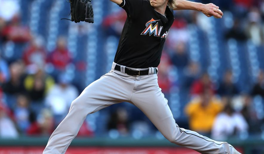 Miami Marlins starting pitcher Adam Conley (61) throws in the first inning of a baseball game against the Philadelphia Phillies, Monday, May 16, 2016, in Philadelphia. (AP Photo/Laurence Kesterson)