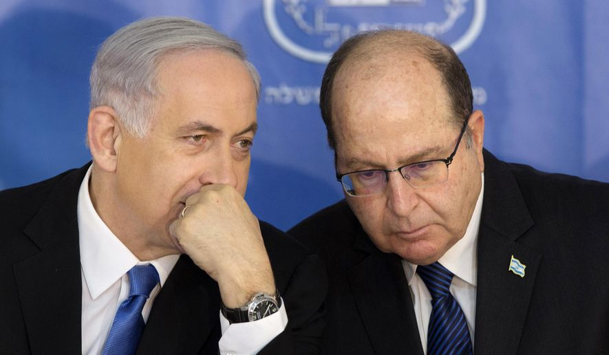 FILE - In this Feb. 16, 2015 file photo, Israeli Prime Minister Benjamin Netanyahu, left, speaks with Israel's Defense Minister Moshe Yaalon during a ceremony for new Israeli Chief of Staff Gadi Eizenkot at the Prime Minister's office in Jerusalem. A public spat between Prime Minister Benjamin Netanyahu and his defense minister has exposed a simmering rift between Israel's security establishment and its hard-line government, pitting the Israeli leader in a risky showdown. (AP Photo/Sebastian Scheiner, File)