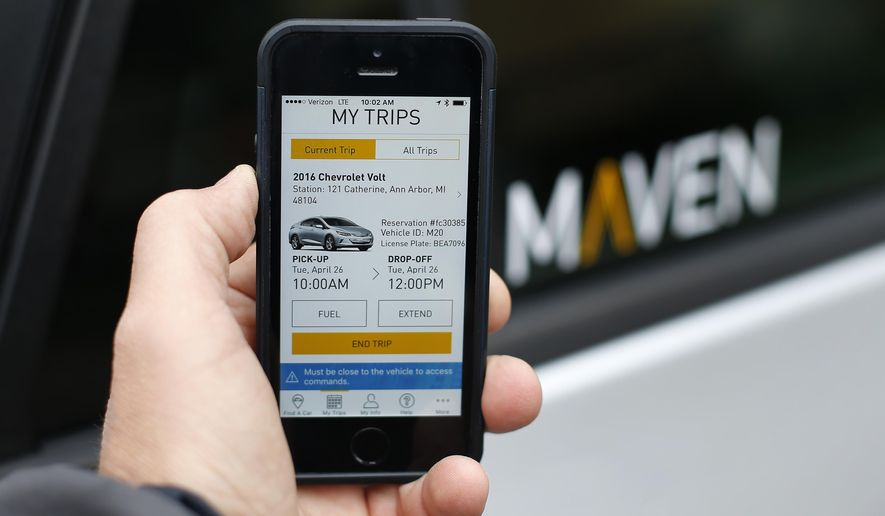 "In this Wednesday, April 27, 2016, photo, a smartphone displaying the Maven app, a General Motors car-sharing service, is shown, in Ann Arbor, Mich. Automakers are reinventing themselves as ""mobility"" companies that can accommodate all the different ways people get around. Already this year, General Motors Co. has announced a long-term alliance with ride-hailing company Lyft and started Maven. (AP Photo/Paul Sancya)"
