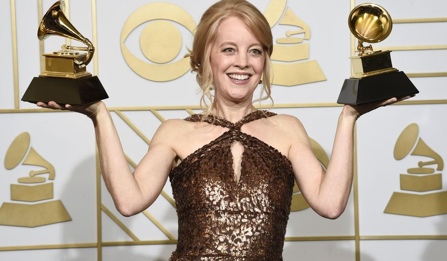 """FILE - In this Feb. 15, 2016 file photo, Maria Schneider poses with the award for best arrangement, instruments and vocals for """"Sue (Or In A Season Of Crime) """" and the award for best large jazz ensemble album for """"The Thompson Fields"""" in the press room at the 58th annual Grammy Awards in Los Angeles. Schneider took home a few 2016 Jazz Awards, one for musician of the year and best album for """"The Thompson Fields."""" She also won for composer, arranger and best large ensemble in voting among members of the Jazz Journalists Association. (Photo by Chris Pizzello/Invision/AP, File)"""