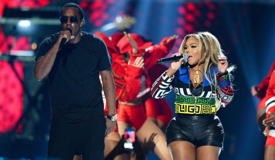 FILE - In this Sept. 19, 2015, file photo, Puff Daddy, left, performs with Lil Kim at the 2015 iHeartRadio Music Festival in Las Vegas. Puff Daddy is reuniting with Lil Kim, Mase, Faith Evans and more for a Bad Boy Records reunion tour kicking off Aug. 25, 2016, in Columbus, Ohio. (Photo by Al Powers/Powers Imagery/Invision/AP, File)