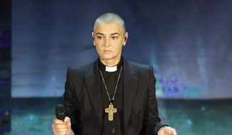 "In this Oct. 5, 2014, file photo, Irish singer Sinead O'Connor performs during the Italian State RAI TV program ""Che Tempo che Fa"", in Milan, Italy. Police in suburban Chicago have put out a well-being check for the Irish singer. Wilmette police released a statement Monday, May 16, 2016, saying O'Connor reportedly left the area for a bicycle ride at 6 a.m. Sunday and hasn't returned. (AP Photo/Antonio Calanni, File)"