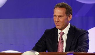 FILE - In this May 21, 2013, file photo, then-Toronto Raptors president Bryan Colangelo, now the president of basketball operations for the Philadelphia 76ers,  represents his team during the NBA basketball draft lottery, in New York.  The Philadelphia 76ers, after finishing with the worst record in the NBA, have the best odds to land the No. 1 pick and could add another in the top five if the pingpong balls bounce their way in Tuesday's draft lottery. (AP Photo/Jason DeCrow)