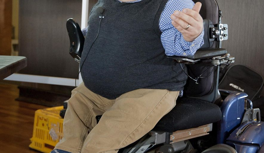 In this Aug. 26, 2014 photo, Samual Gibson speaks at a fundraising event for the Cranford Hospice in Hastings, New Zealand. Gibson, who inspired many by defying the brittle bones he was born with and pursuing a life filled with rigorous outdoor adventures, died Monday, May 16, 2016, after falling from his wheelchair while competing in a half-marathon. He was 39.(Glenn Taylor/Hawkes Bay Today via AP) NEW ZEALAND OUT, AUSTRALIA OUT