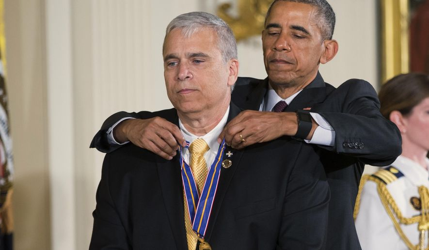 President Barack Obama presents the Medal of Valor to Officer Mario Gutierrez, of the Miami-Dade Police Department, Fla., during a ceremony in the East Room of the White House in Washington, Monday, May 16, 2016. The Medal of Valor is awarded to public safety officers who have exhibited exceptional courage, regardless of personal safety, in the attempt to save or protect others from harm. (AP Photo/Evan Vucci)