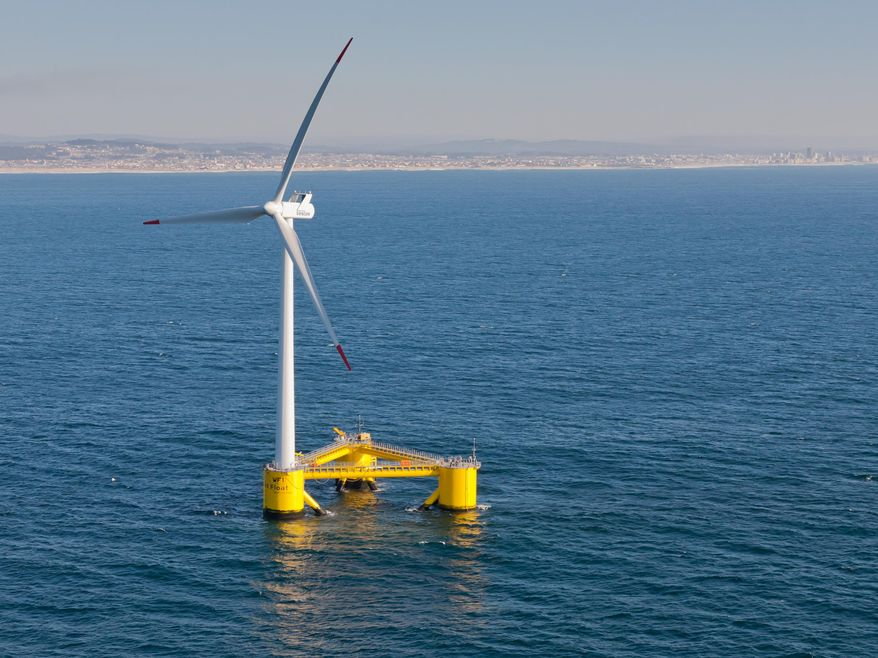 This Nov. 2013, photo provided by Principle Power shows a WindFloat Prototype (WF1) operating at rated power (2MW), 3.1 miles offshore of Aguadoura, Portugal. Massive wind turbines could end up floating in deep ocean waters off Hawaii's shores under proposals to bring more renewable energy to the islands. Two companies have proposed offshore wind turbine projects for federal waters off Oahu as Hawaii pushes to meet its aggressive renewable energy goals. Hawaii has set a goal for its utilities to use 100 percent renewable energy by the year 2045. (Joshua Weinstein/Principle Power via AP) MANDATORY CREDIT
