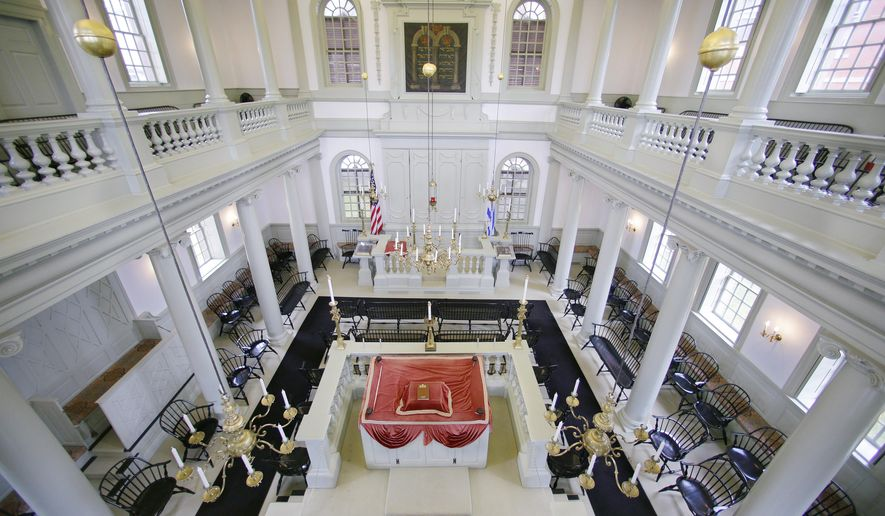 "FILE - In this Thursday, May 28, 2015 file photo, an interior view of the Touro Synagogue, the nation's oldest, is seen from the ""ladies gallery"" in Newport, R.I. A federal judge on Monday, May 16, 2016, awarded control of Touro and a pair of ceremonial bells valued at more than $7 million to the congregation that worships there. A lawsuit pitted the congregants against the nation's oldest Jewish congregation in New York City which became trustee of Touro in the 1820s after Jews left, Newport. (AP Photo/Stephan Savoia, File)"