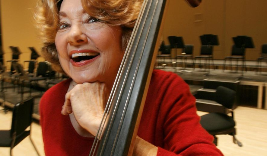 In this Nov. 15, 2007 photo, Jane Little, an Atlanta Symphony Orchestra bassist, poses for a photo in Atlanta. Little, whose career spanned a world-record with a single orchestra, has died at age 87 after collapsing onstage Sunday, May 15, 2016, during a performance. (Louie Favorite/Atlanta Journal-Constitution via AP)  MARIETTA DAILY OUT; GWINNETT DAILY POST OUT; LOCAL TELEVISION OUT; WXIA-TV OUT; WGCL-TV OUT; MANDATORY CREDIT