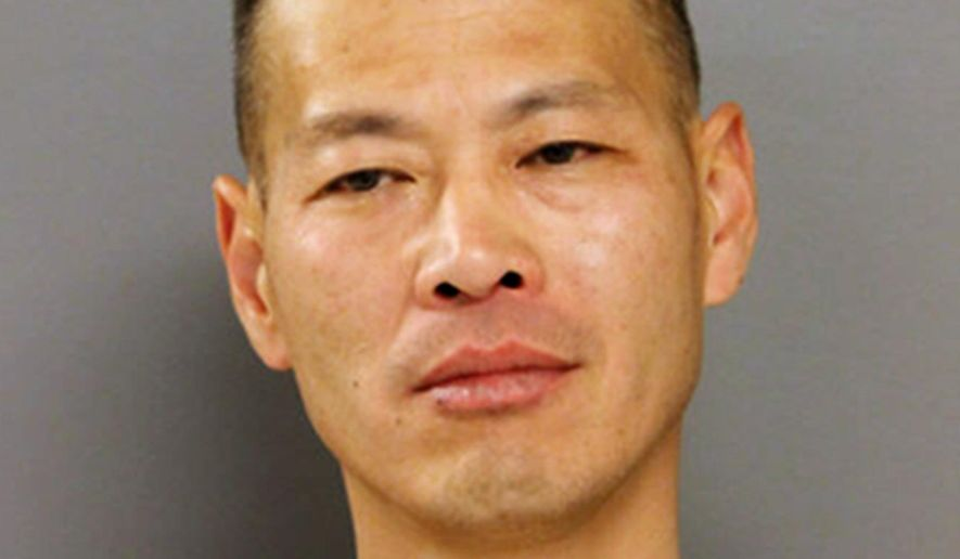 This photo provided by the Chicago Police Department shows Hong Chu of Chicago, who was arrested Sunday, May 15, 2016, and charged with impersonating a police officer. Chu has twice been convicted of falsely impersonating a police officer and was on probation for his second offense when he was arrested. (Chicago Police Department via AP)