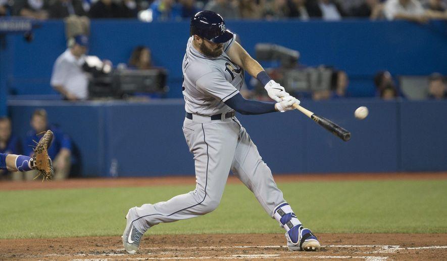 Tampa Bay Rays' catcher Curt Casali hits a three-run home run off Toronto Blue Jays' relief pitcher Dustin Antolin during the third inning of a baseball game in Toronto, Monday, May 16, 2016. (Chris Young/The Canadian Press via AP)